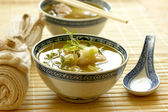 Asian fish soup with noodle — Stock Photo