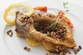 Carp fillet on organic potato — Stock Photo