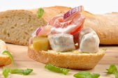 Herring salad on bread — Stock Photo