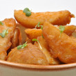 Fried potato wedges - Stock Photo