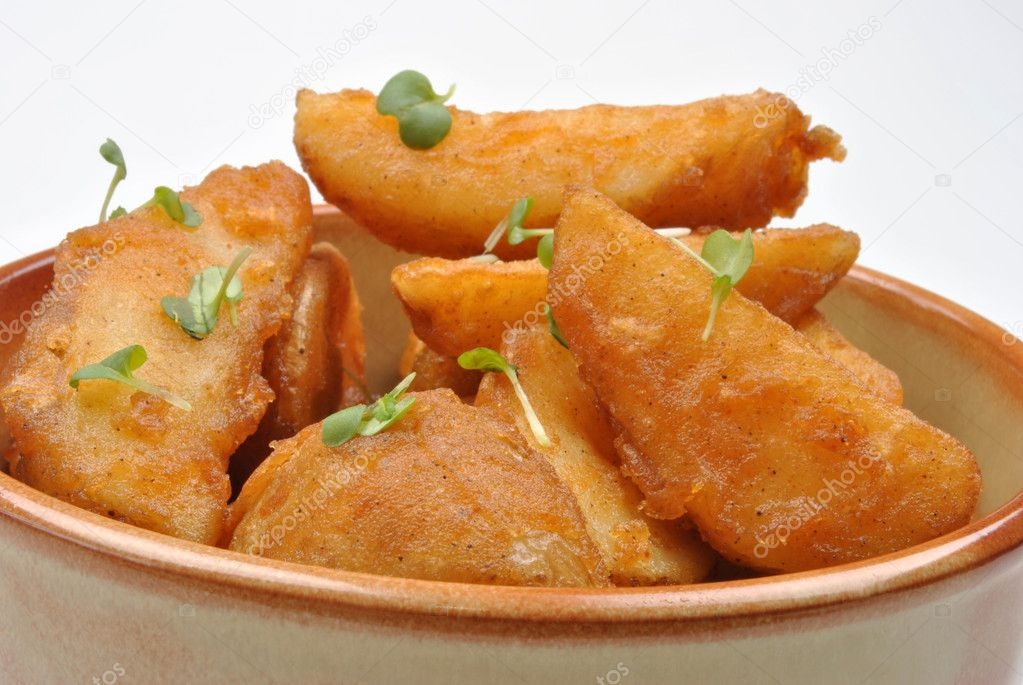 Some fried potato wedges in a bowl — Stock Photo #1746608