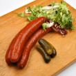 Stock Photo: Smoked sausage and organic gherkin