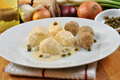 Cooked meatballs in a white sauce — Stock Photo