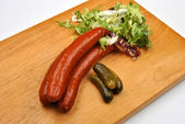 Smoked sausage and organic gherkin — Stock Photo