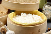 Rice steamed in a bamboo steamer — Stock Photo