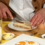 Woman having breakfast — Stock Photo #2226076