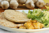 Naan bread with turkey curry — Stock Photo