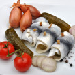 Organic rollmops on a white plate — Stock Photo