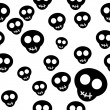 Stock Vector: Seamless pattern with black skulls