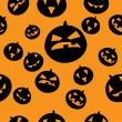 Seamless pattern with black pumpkins — Stock Vector