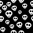 Stock Vector: Seamless pattern with white skulls