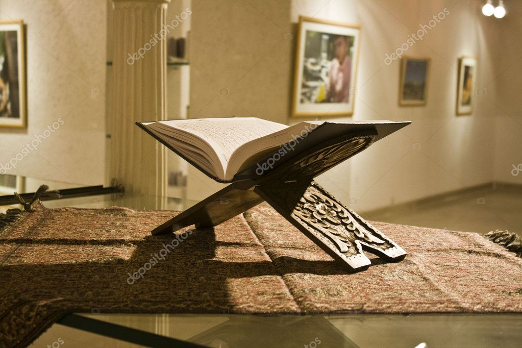 An open Holy book lying on the table in a room.  — Stock Photo #1626782