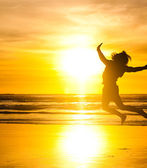 Jumping at Piha beach — Stock Photo
