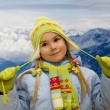 Little girl in mountains — Stock Photo #1559222