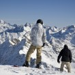 Snowboarders on the peak of mountain — Stock Photo #1576993