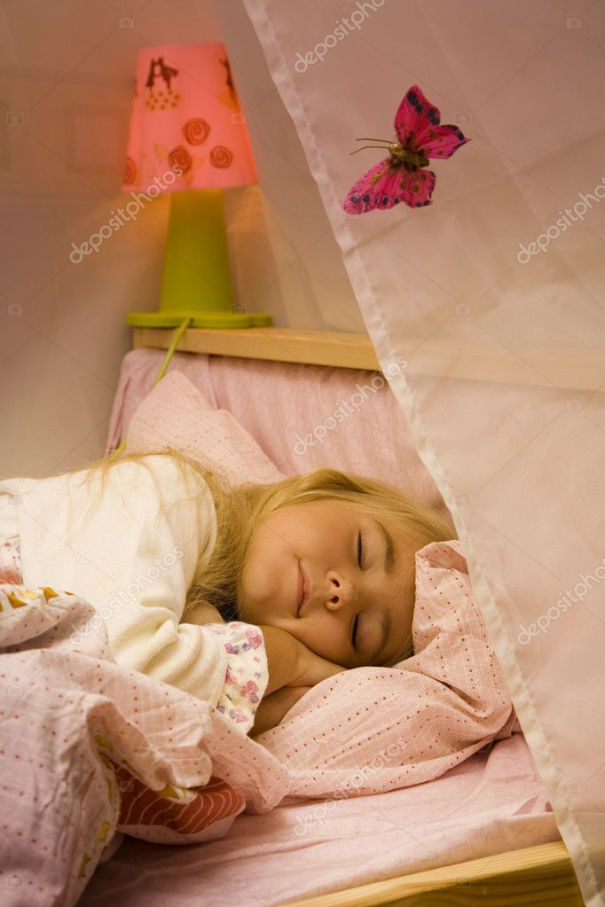 Little girl sleep in her bed — Stock Photo #1578002