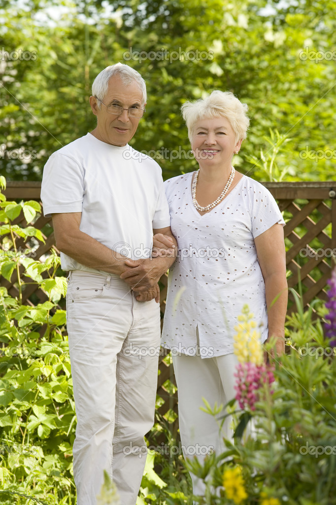Mature loving couple in the garden — Stock Photo #1725581