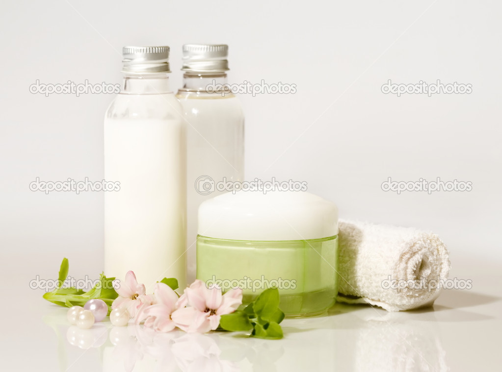 Composition of cosmetic products with flower — Stock Photo #1774909