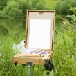 Easel, canvas, and brushes — Stock Photo
