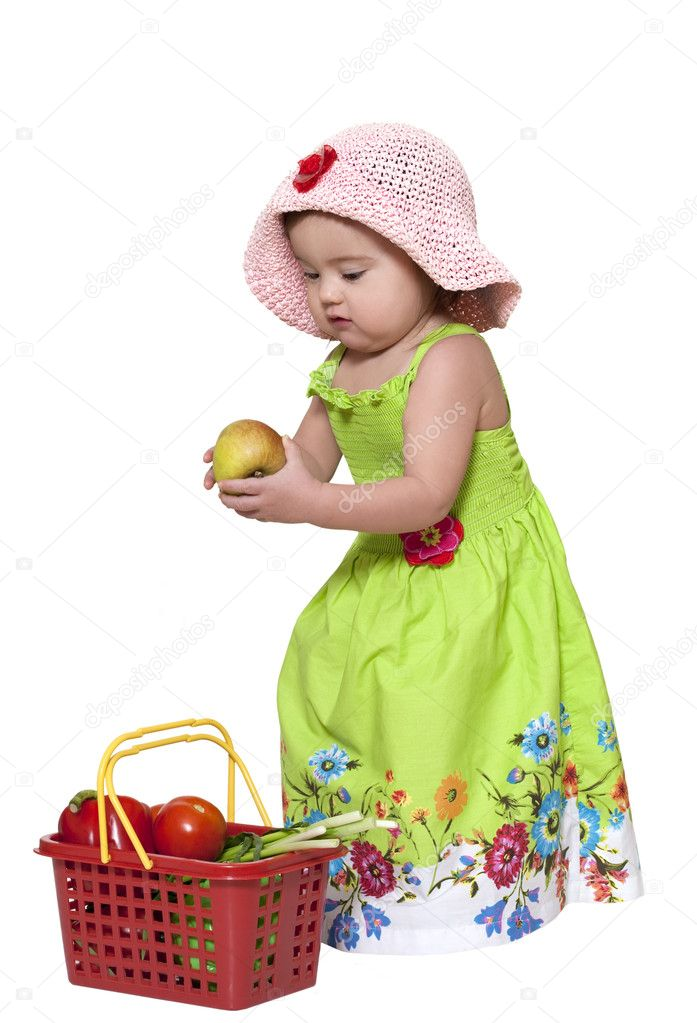 Toddler standing near fruit basket over white  Stock Photo #2419193