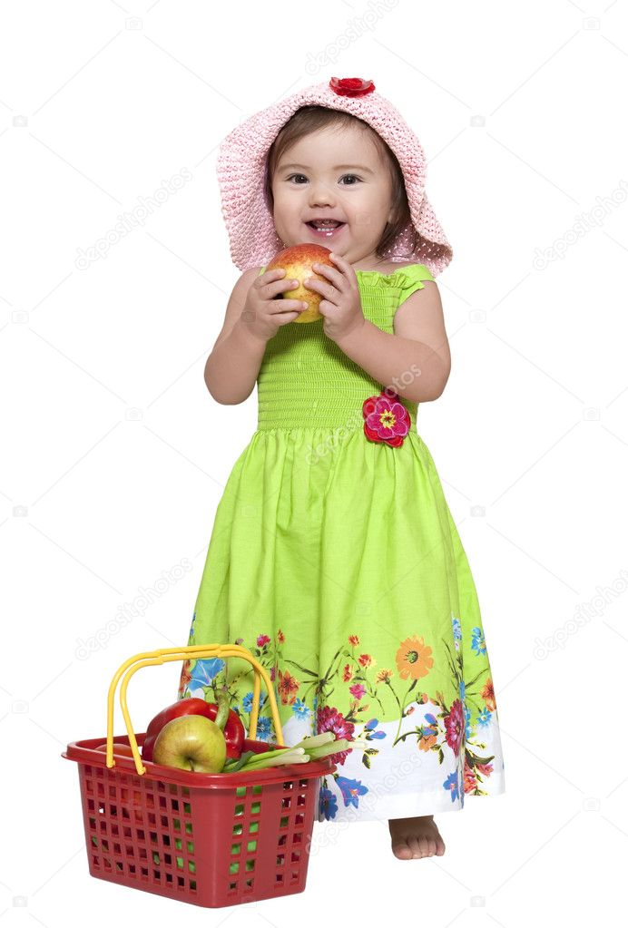 Toddler standing near fruit basket over white — Stock Photo #2419201