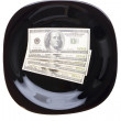 Concept. Dollars on the black plate — Stock Photo