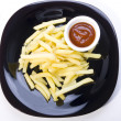 Fries with the sauce on the plate — Stock Photo