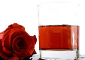 Red cocktail and rose — Stock Photo