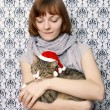 Girl with a Christmas cat — Stock Photo