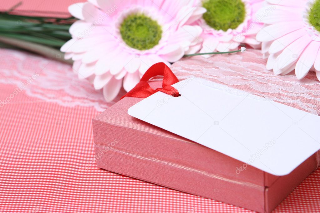 Beautiful celebratory card with colours and a gift — Stock Photo #1790715