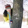 Foto Stock: Teen girl with snowball, surprised