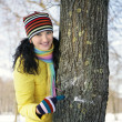 Teen girl with snowball, surprised — Stock Photo