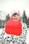 Beautiful girl snowborder — Stock Photo