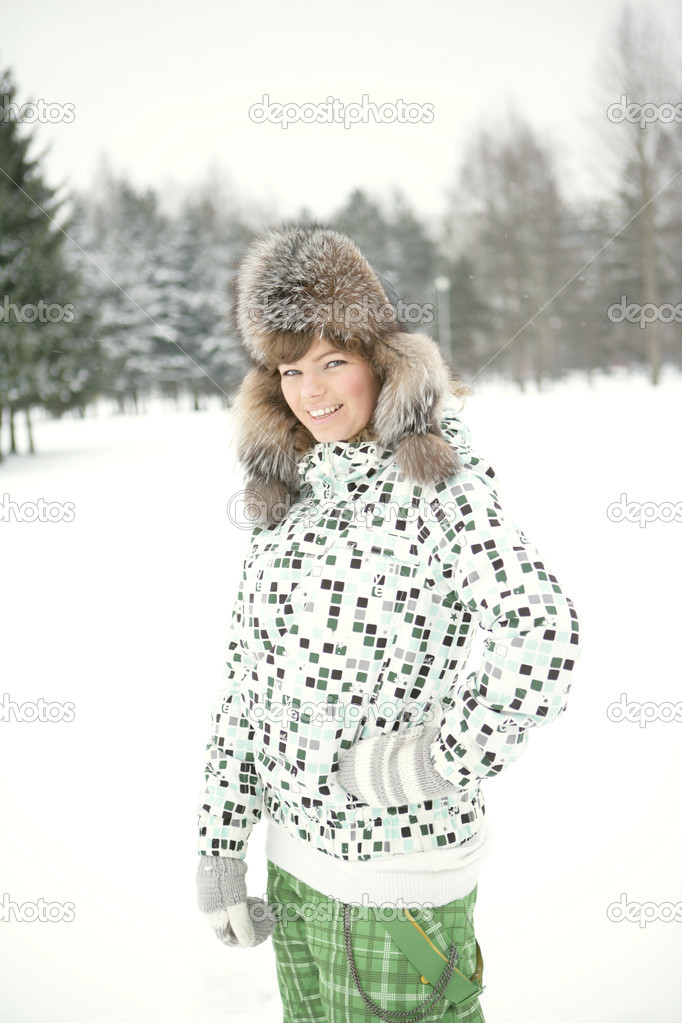 Beautiful girl in winter hat and mittens mehavoy laughs  Stock Photo #2076737
