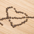 Coffee heart pierced by an arrow — Stock Photo