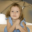 Small pretty girl with umbrella — Stock Photo