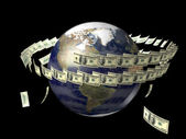 Earth with flying dollars around it — Stock Photo