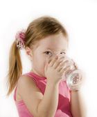 Small girl is drinking the water — Stock Photo