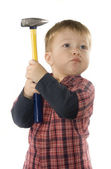 Small boy is keeping hammer — Stock Photo