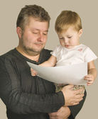 Father with son are looking the picture — Stock Photo