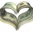 Valentine heart shape made by dollars - Stock Photo