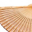 Stock Photo: A wooden fan isolated on white