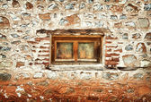 The window of an old abandoned house — Stock Photo