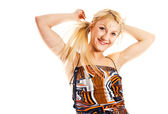 A happy young blonde dancing — Stock Photo