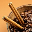Coffee and cinnamon sticks — Stock Photo
