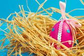 Easter egg on blue background — Stock Photo