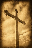 Grungy cross silhouette with clouds in t — Stock Photo
