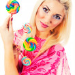 Beautiful blonde with lollipops — Stock Photo