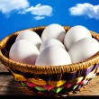 White eggs in a basket — Stock Photo