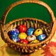 Painted Easter eggs in a basket - Stock Photo